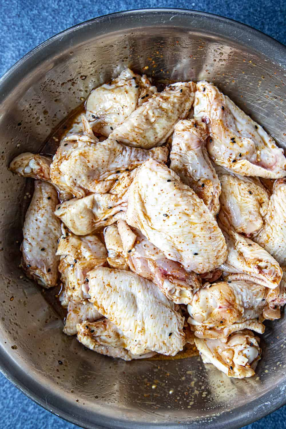 Marinating the chicken wings in a bowl with my grilled chicken marinade