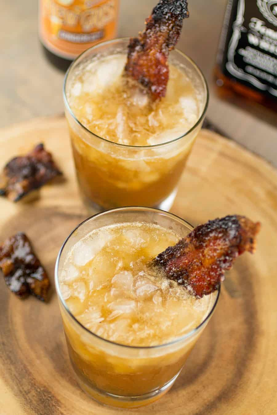 Smoky Whiskey Mule Cocktail in a glass with candied bacon