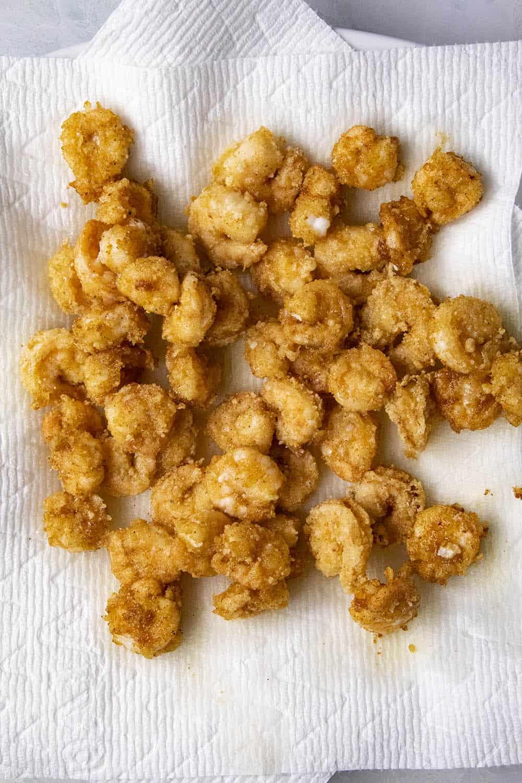 Fried bang bang shrimp, draining the oil