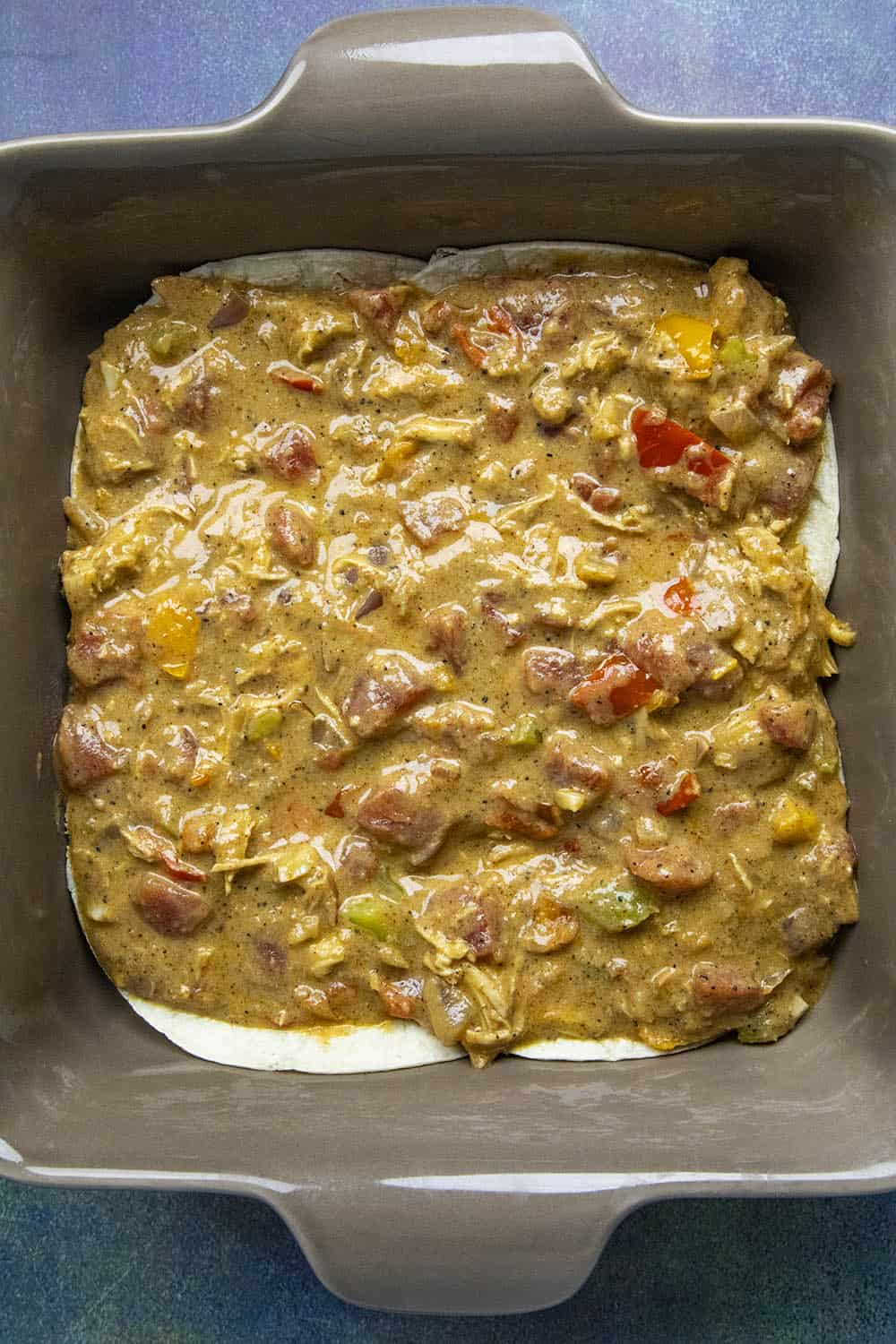 Layering in the filling of the King Ranch Casserole
