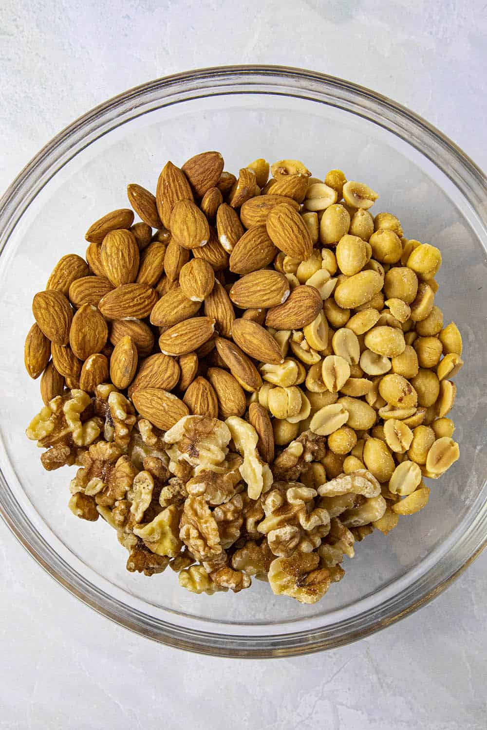 Raw pecans, almonds and peanuts for making spiced nuts