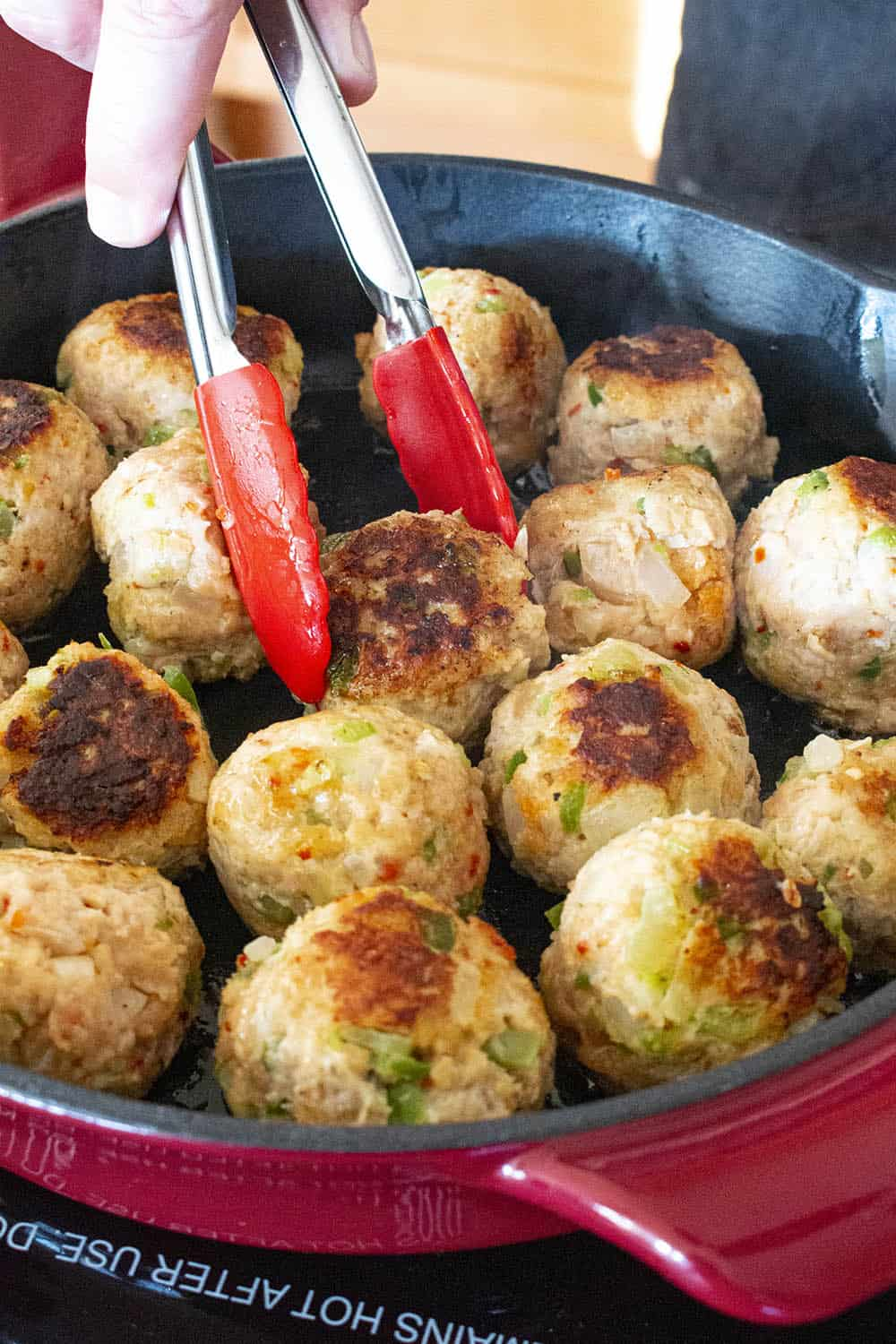 Searing off my chicken meatballs in a pan