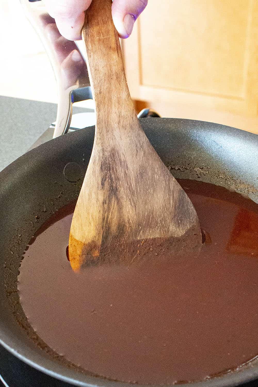 Spicy Korean gochujang glaze in a pan, ready for the meatballs