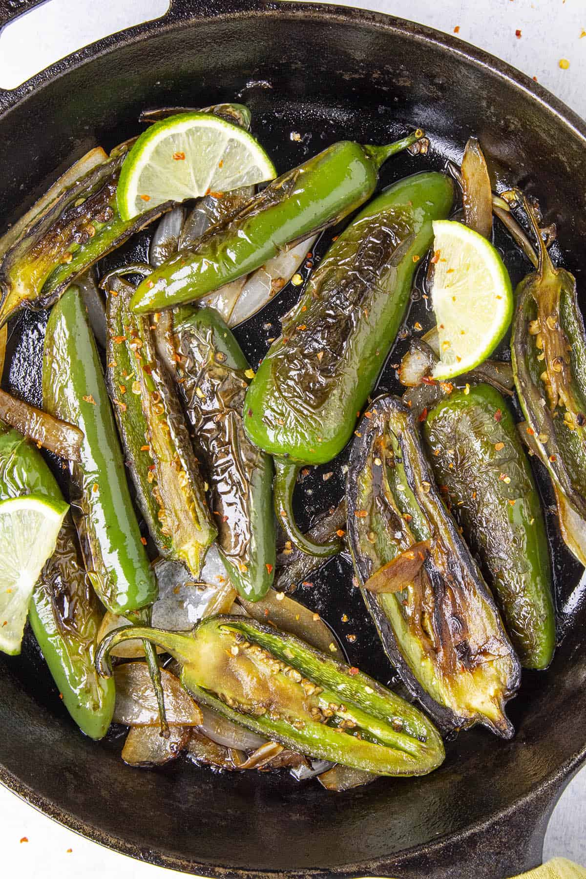 Chiles Toreados, or blistered chiles, in a pan, ready to serve