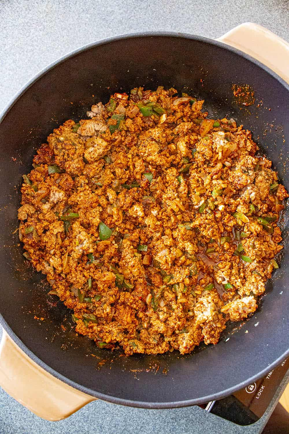 Seasoning added to the ground meat in the pan