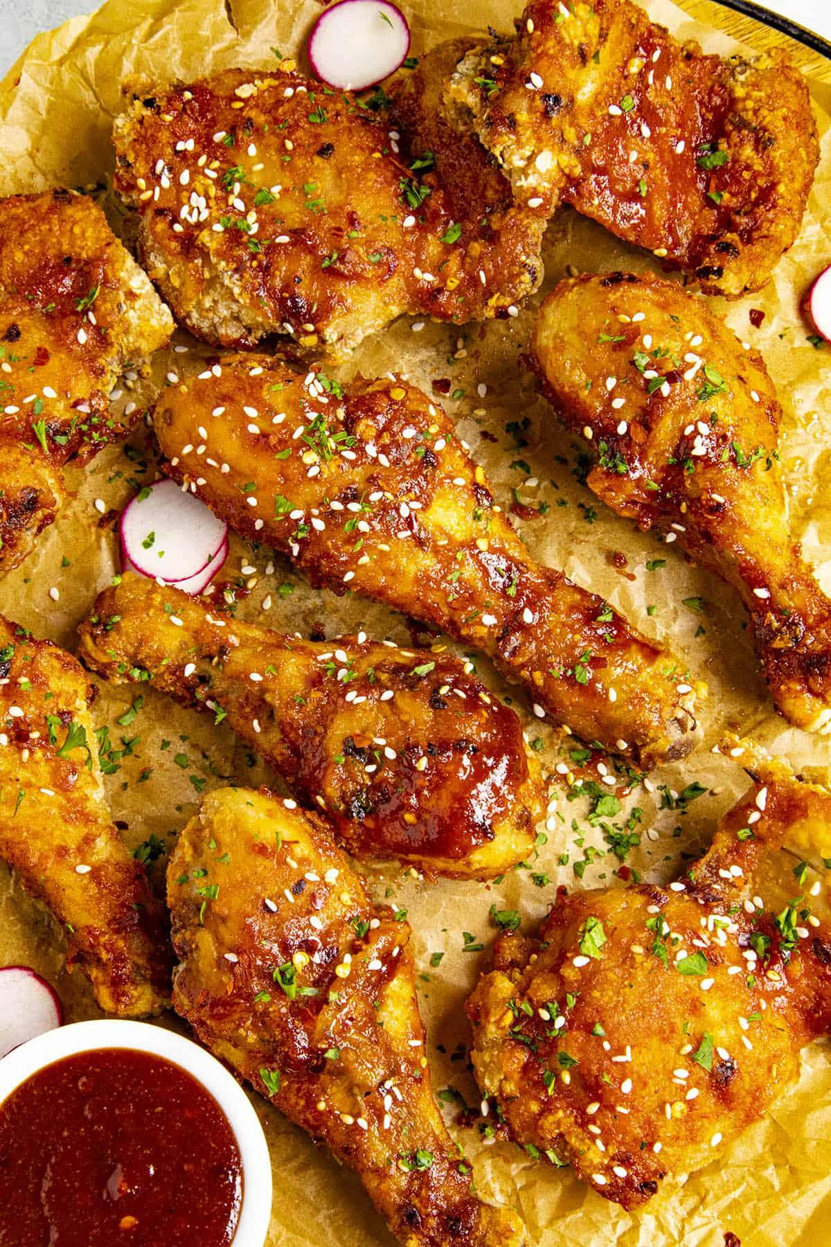 Korean Fried Chicken on a platter with garnish