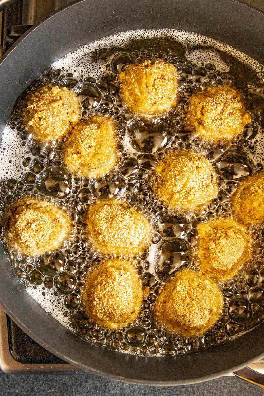 Boudin balls frying in a pan