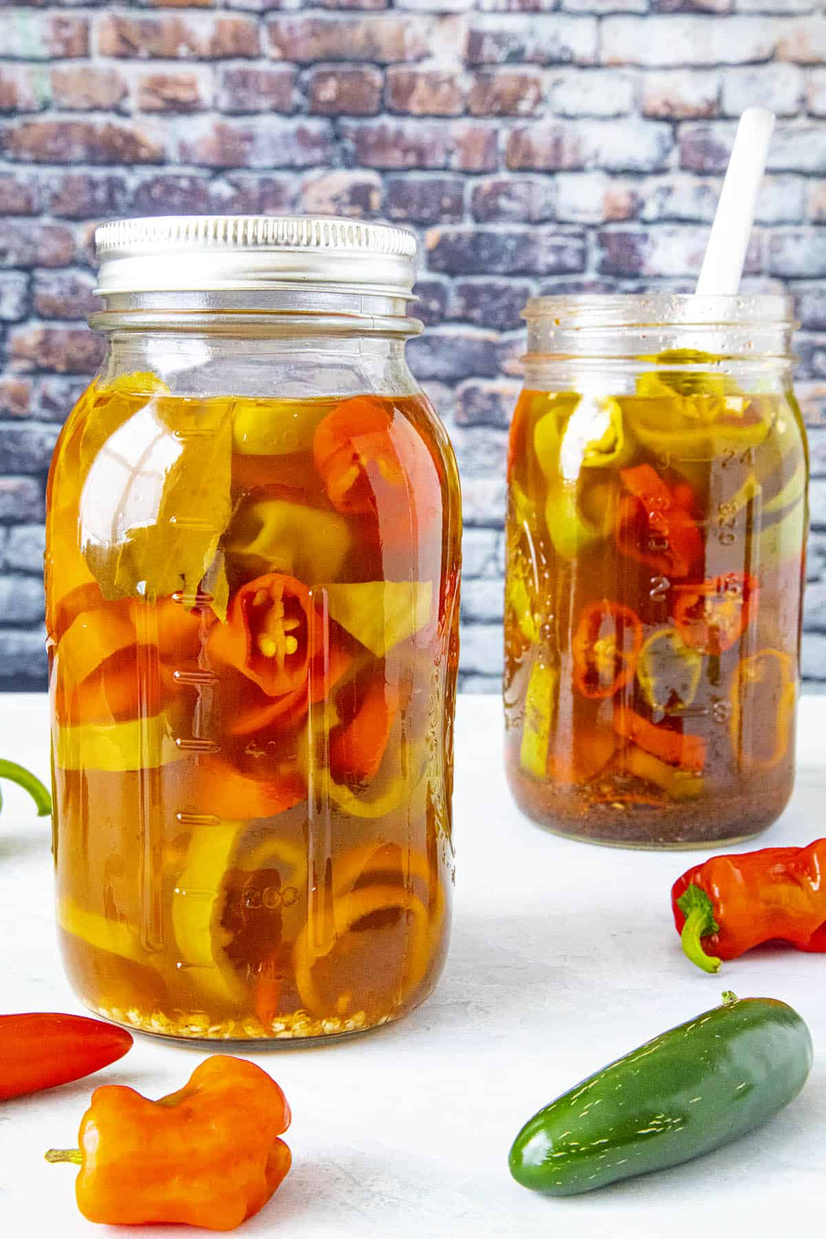 Pickled peppers in 2 jars