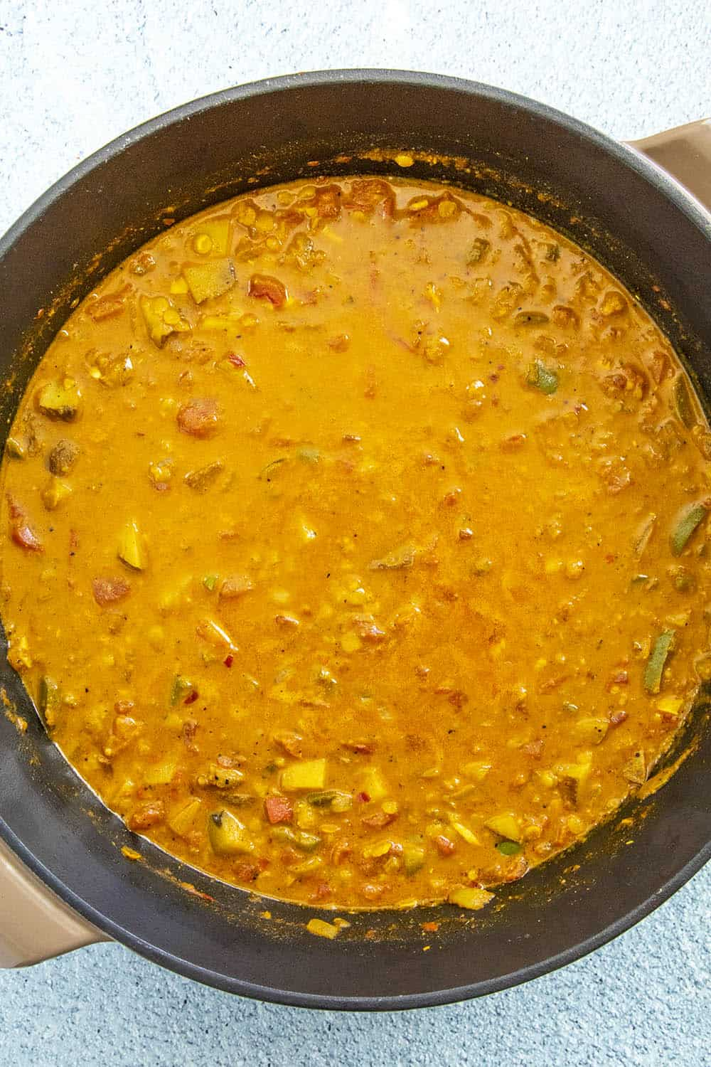 Masoor Dal (Red Lentil Curry) in a pot, simmering
