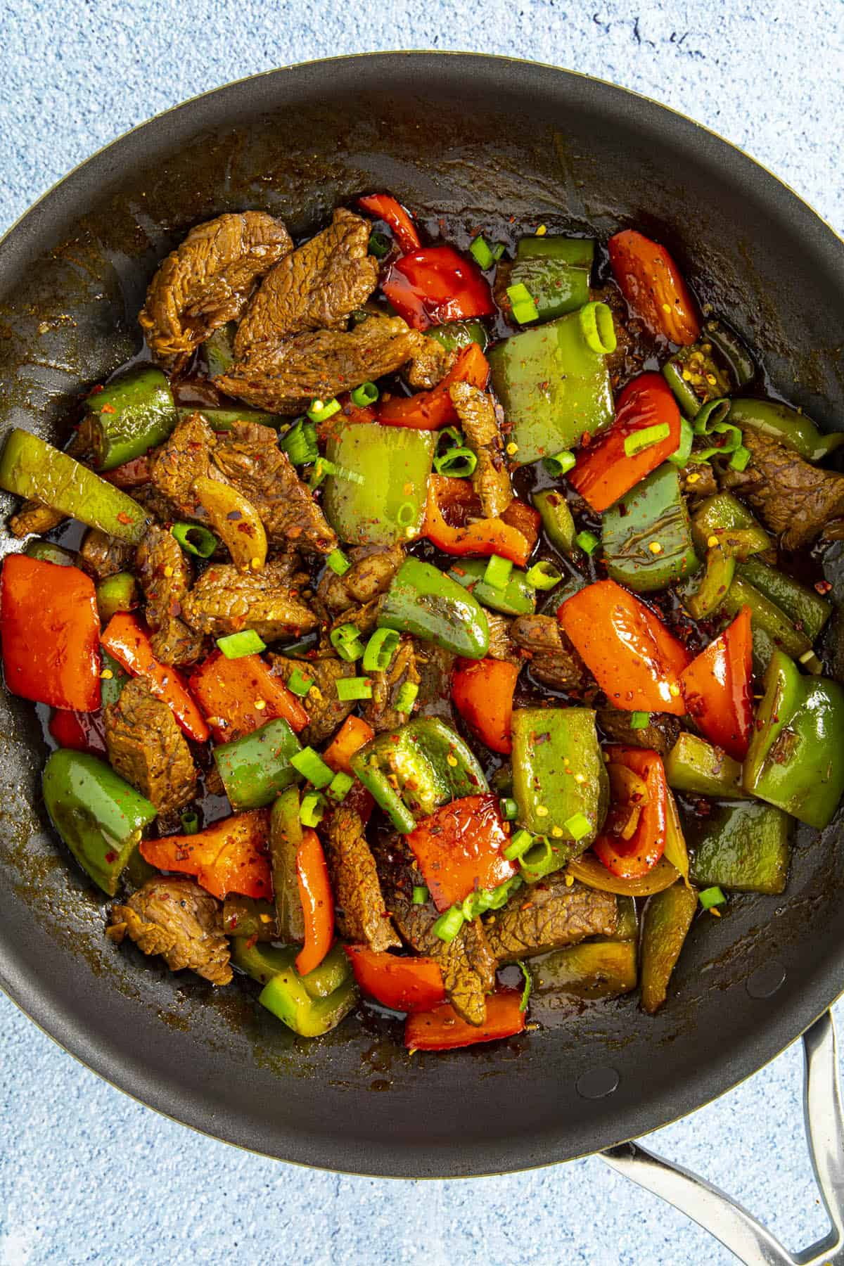 Pepper steak in a pan with garnish