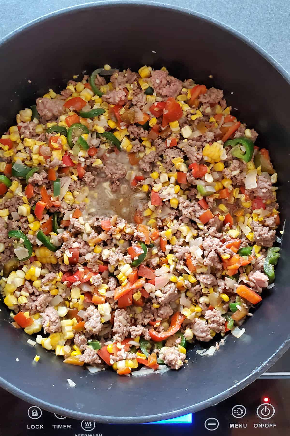 Meat and vegetables cooked down to make taco soup