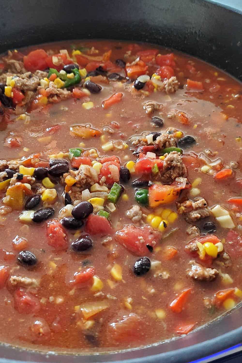 Simmering the taco soup in a pot