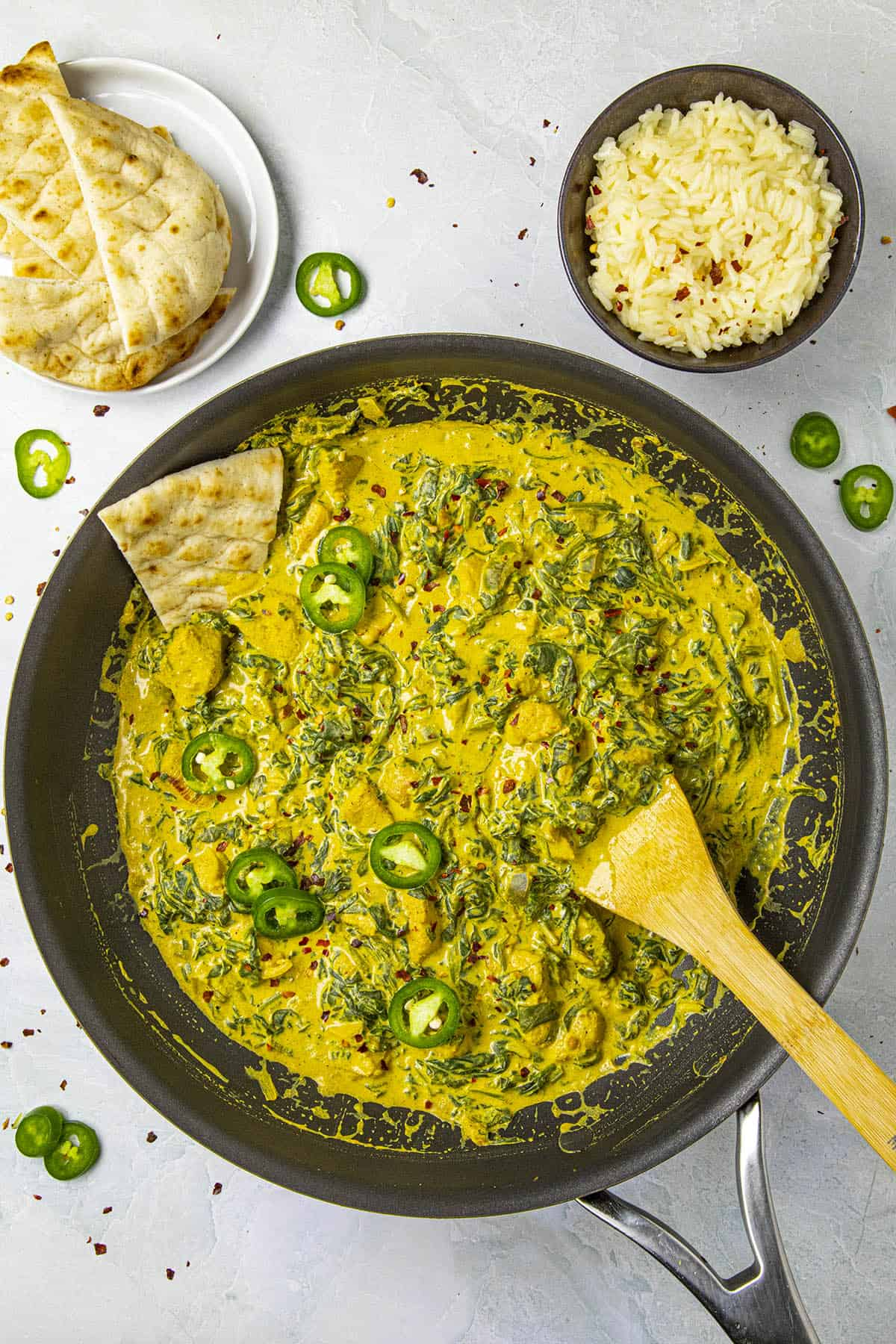 Chicken Saag with lots of peppers for garnish, ready to serve