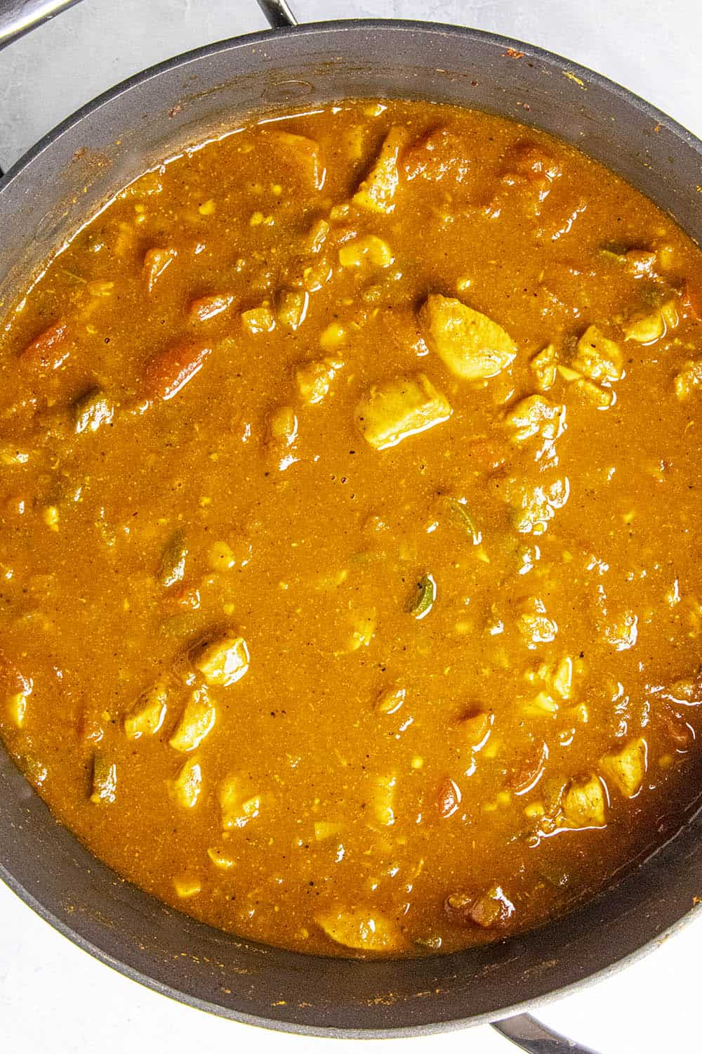 Spicy Chicken Phall Curry simmering in the pot