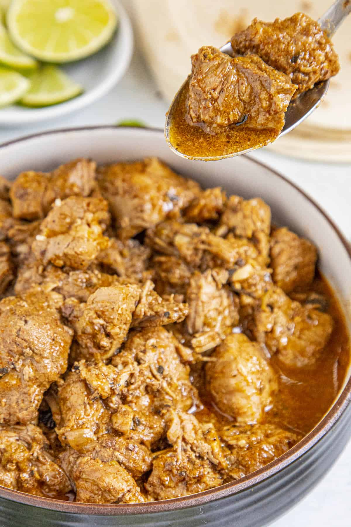 Chunky pieces of Carne Adovada on a spoon