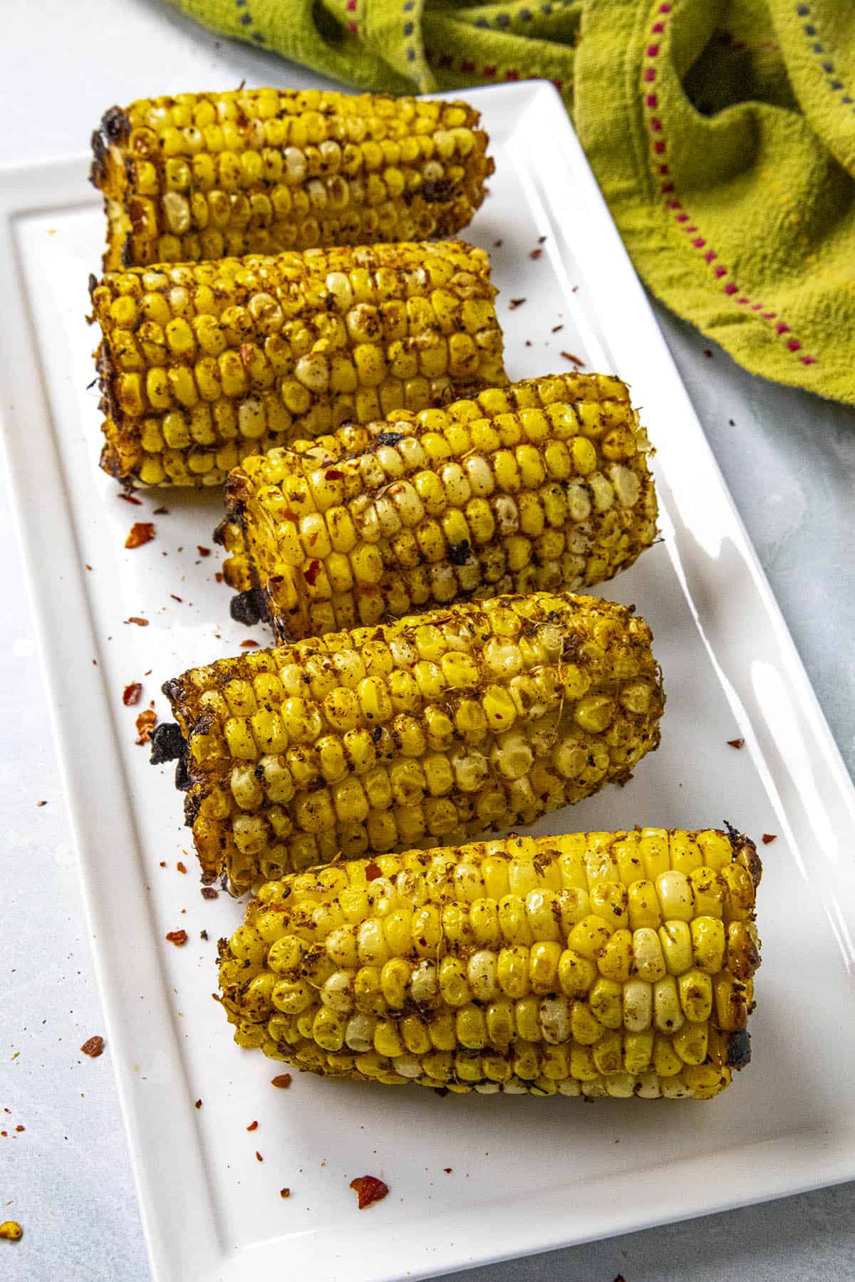 Grilled corn on the cob with plenty of jerk seasonings