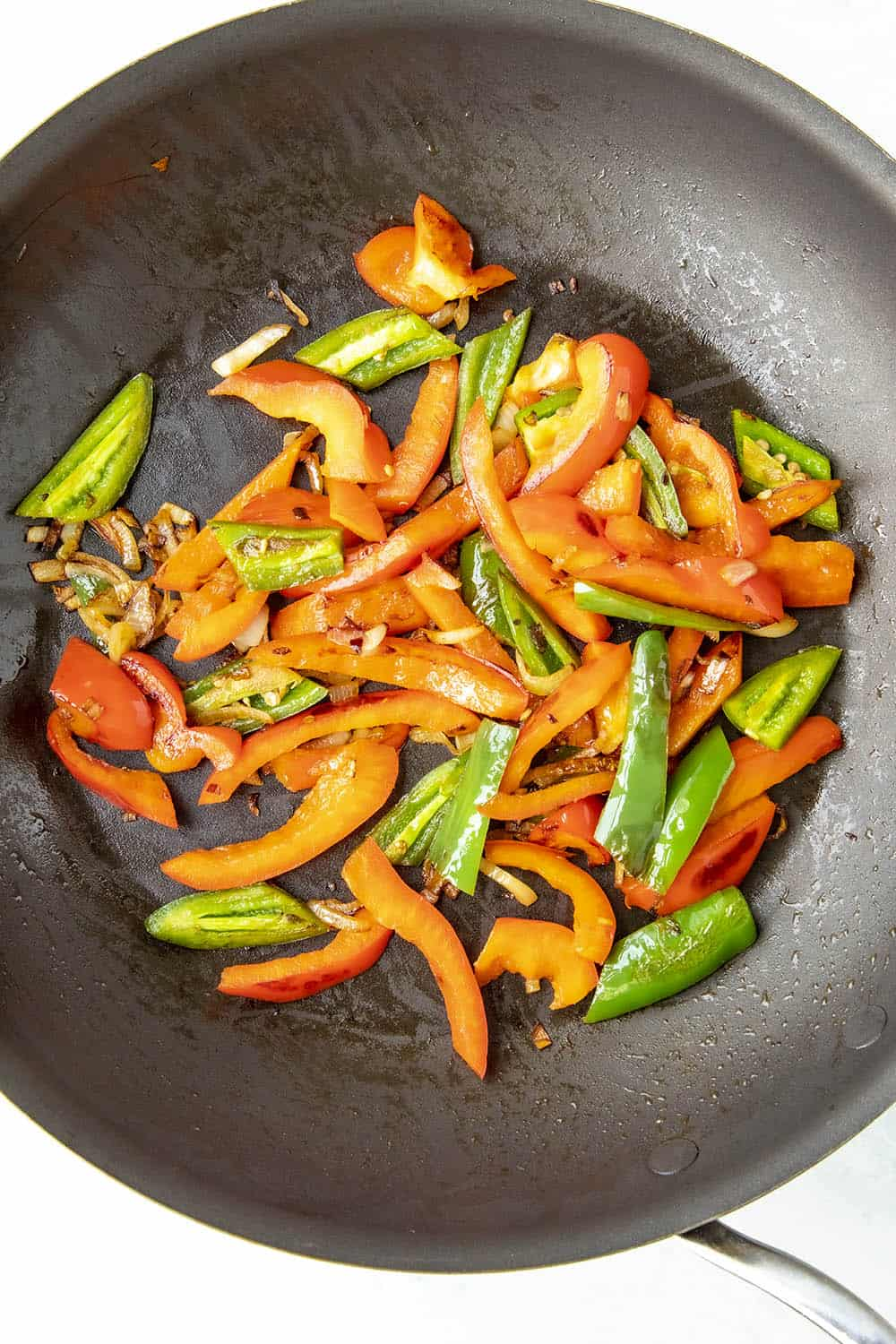Cooking down peppers for a pepper and egg sandwich