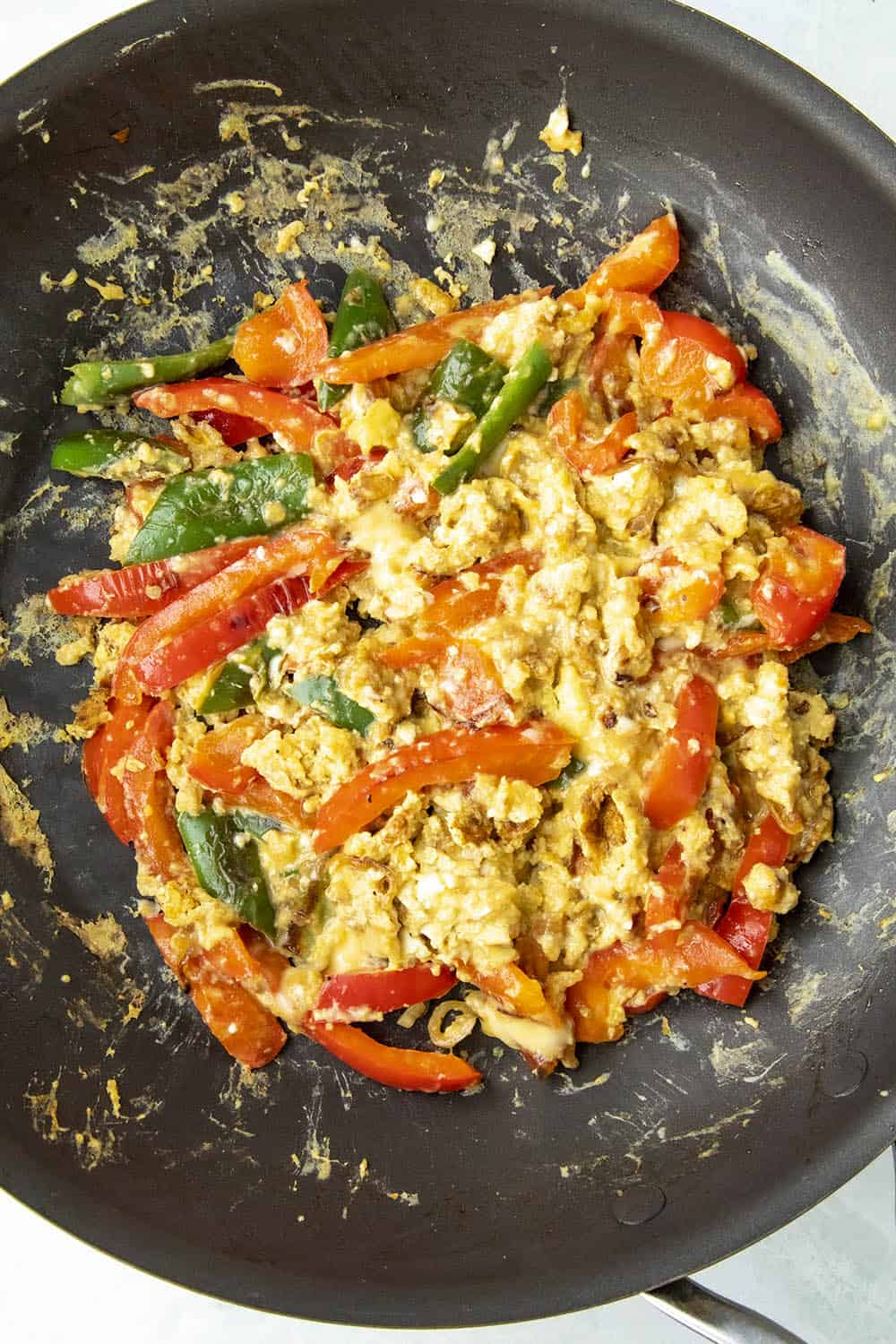Scrambled eggs with peppers in a pan