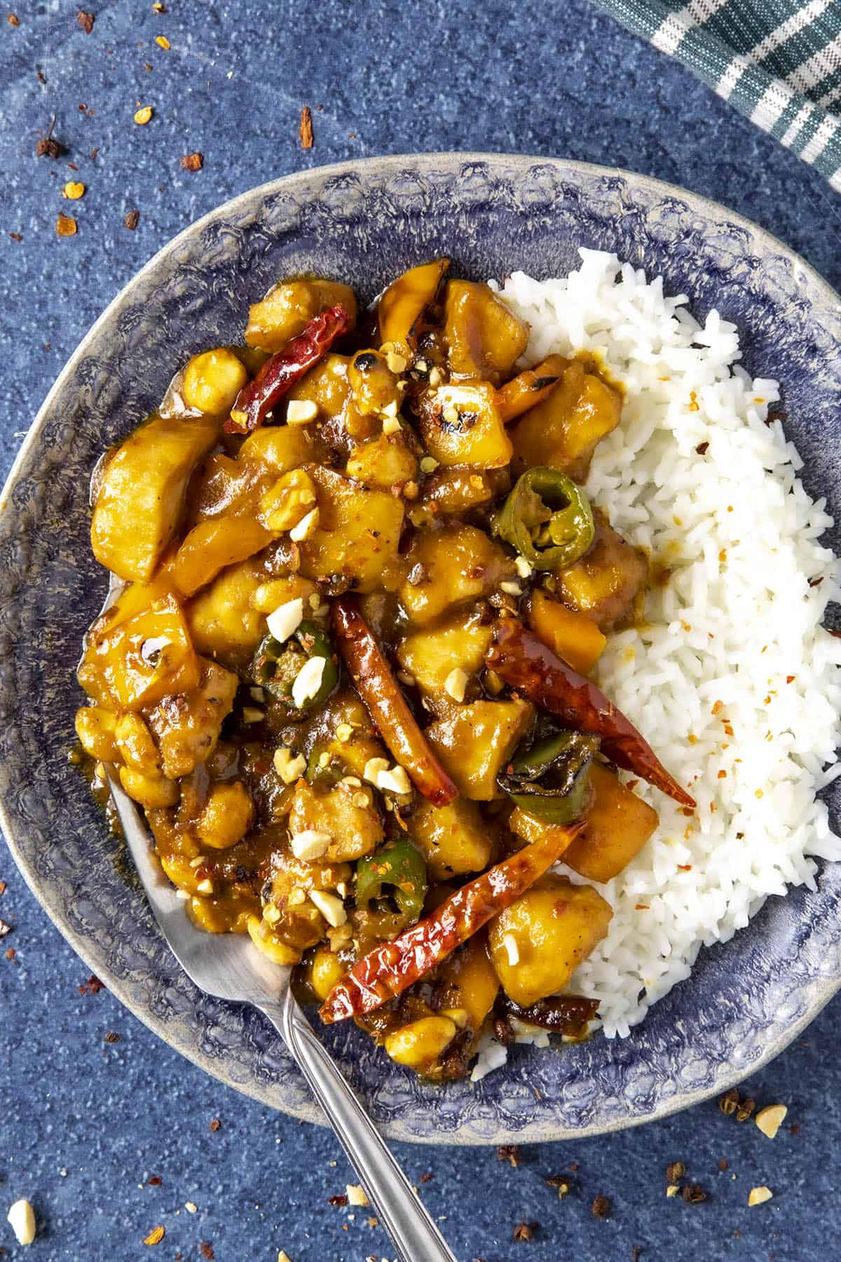 Szechuan Chicken on a plate with lots of peppers