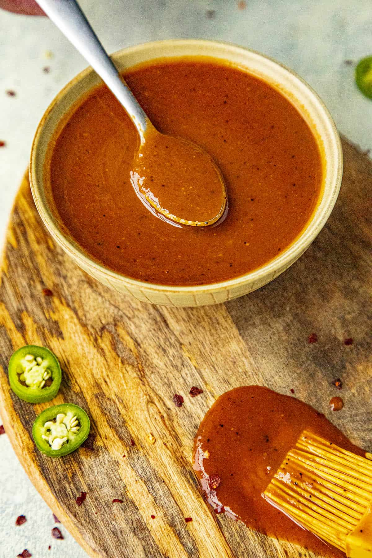 Sweet and Spicy BBQ Sauce on a spoon, ready to serve