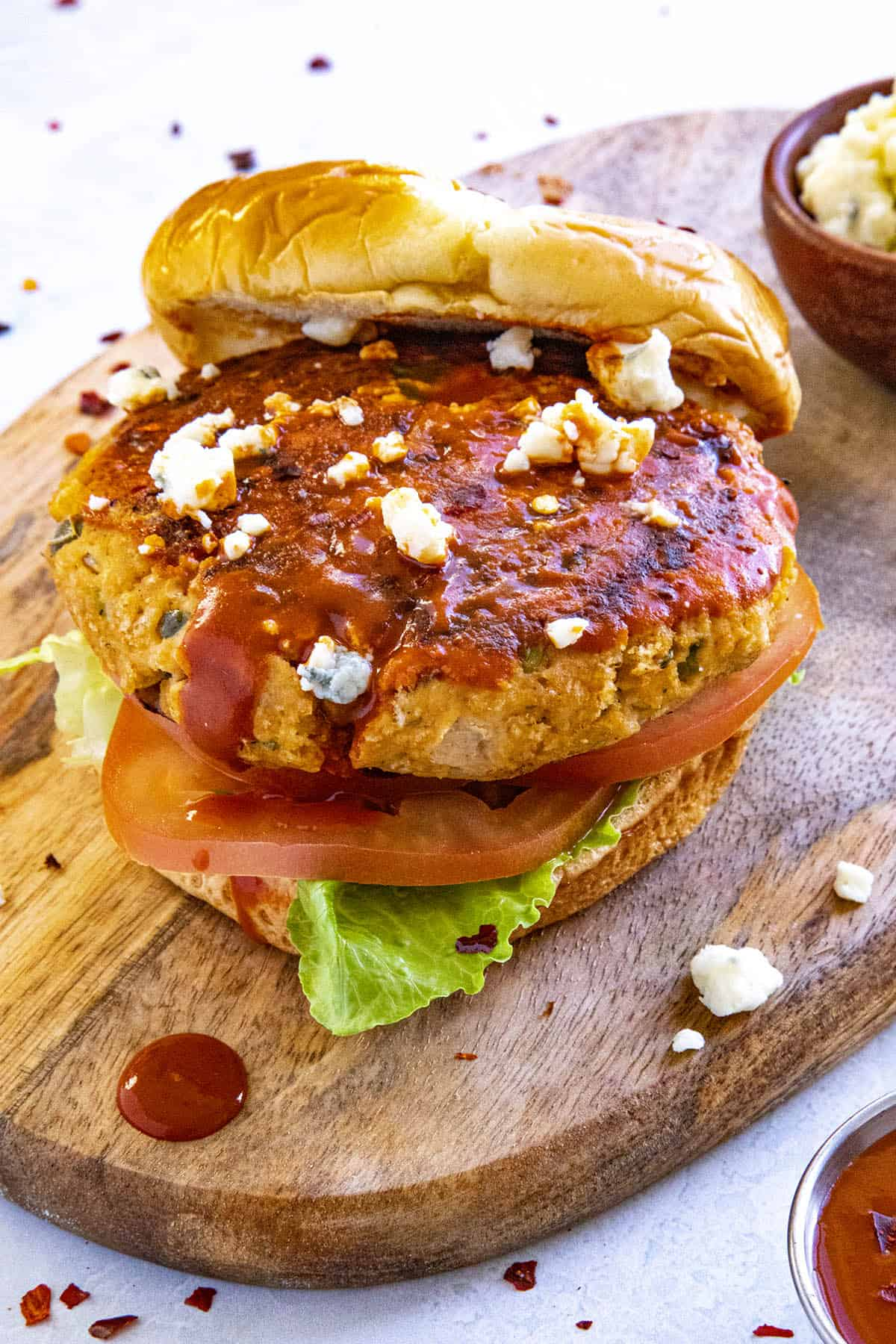 A Buffalo chicken burger with lots of crumbly blue cheese