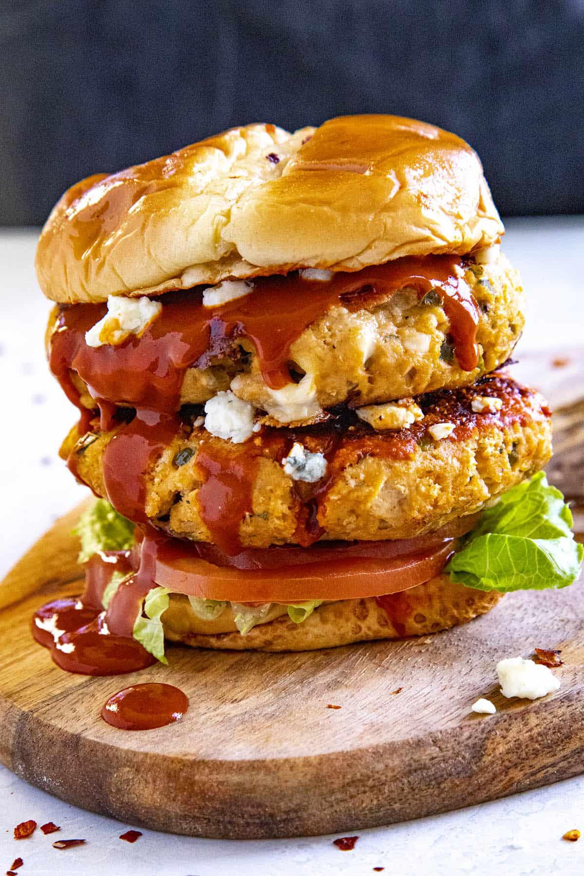 A double Buffalo chicken burger dripping with Buffalo sauce