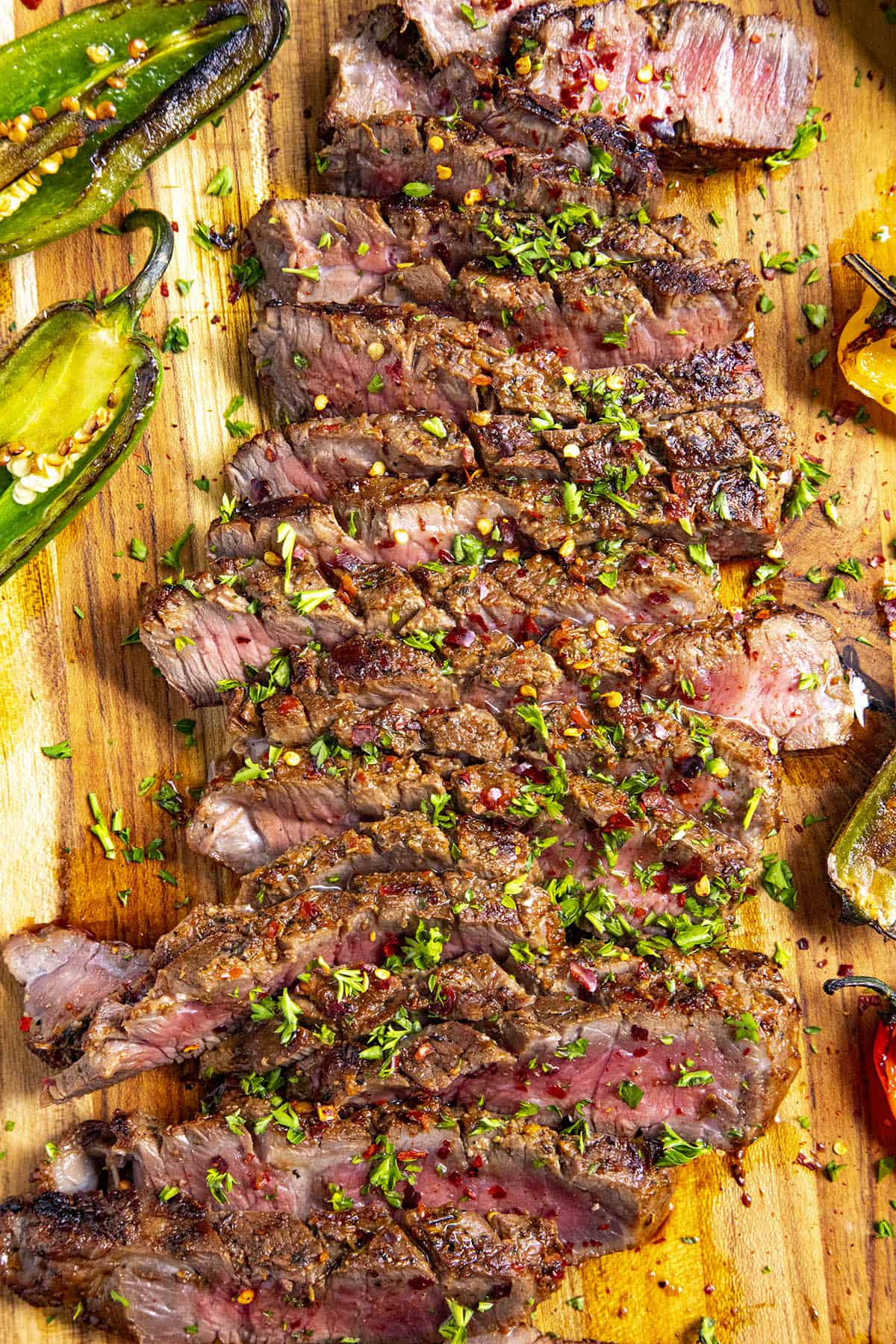 Sliced London broil on a platter with garnish