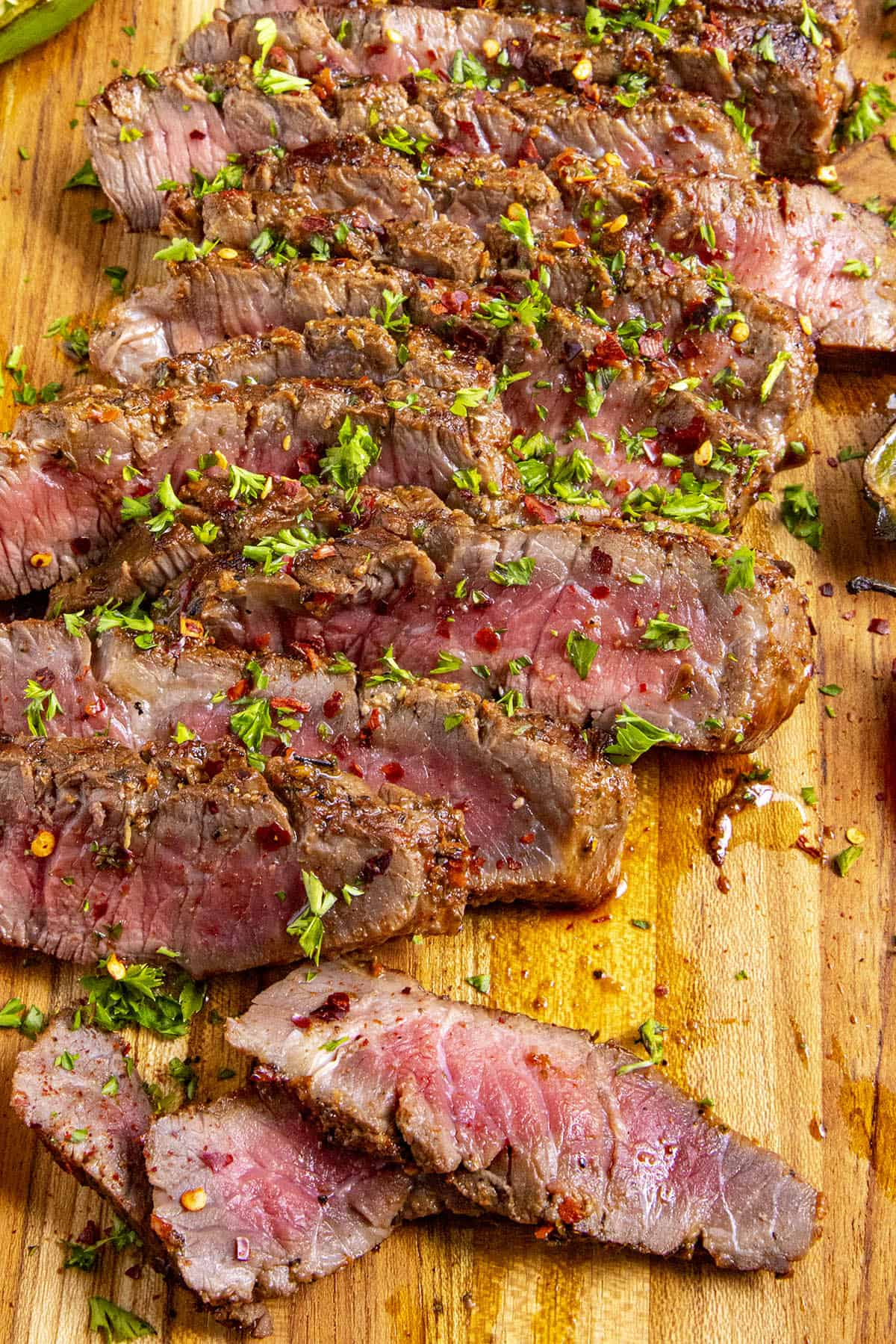 Sliced London broil on a cutting board