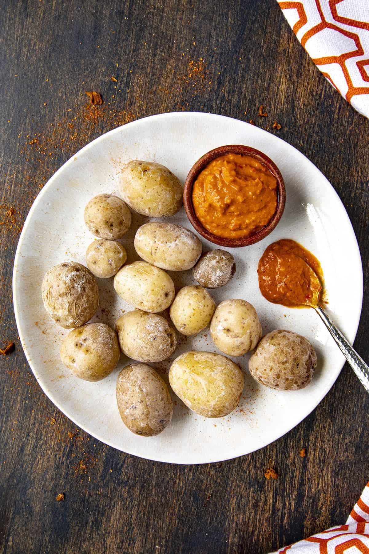 Papas Arrugadas (wrinkly potatos), on a plate with mojo picon