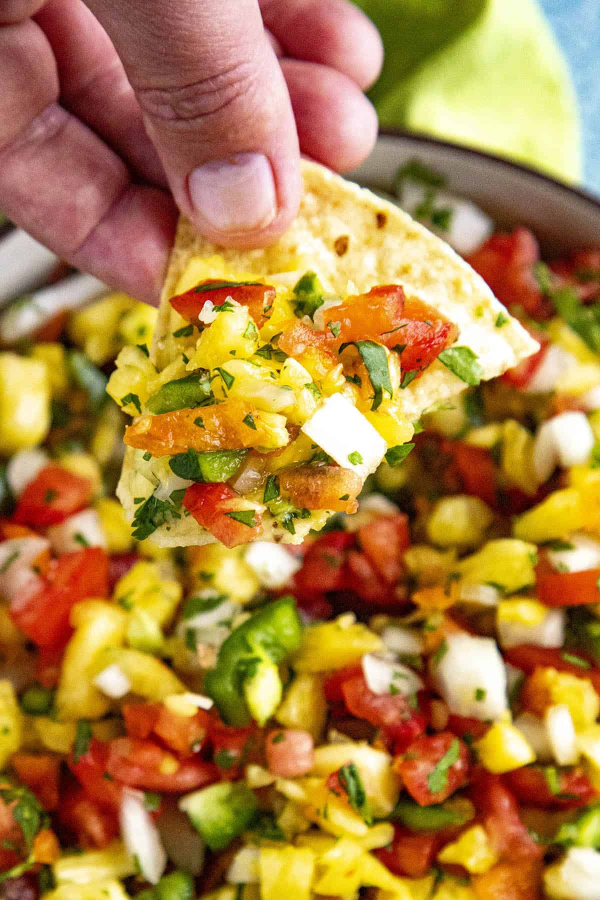 Spicy Pineapple Salsa with habanero peppers on a chip