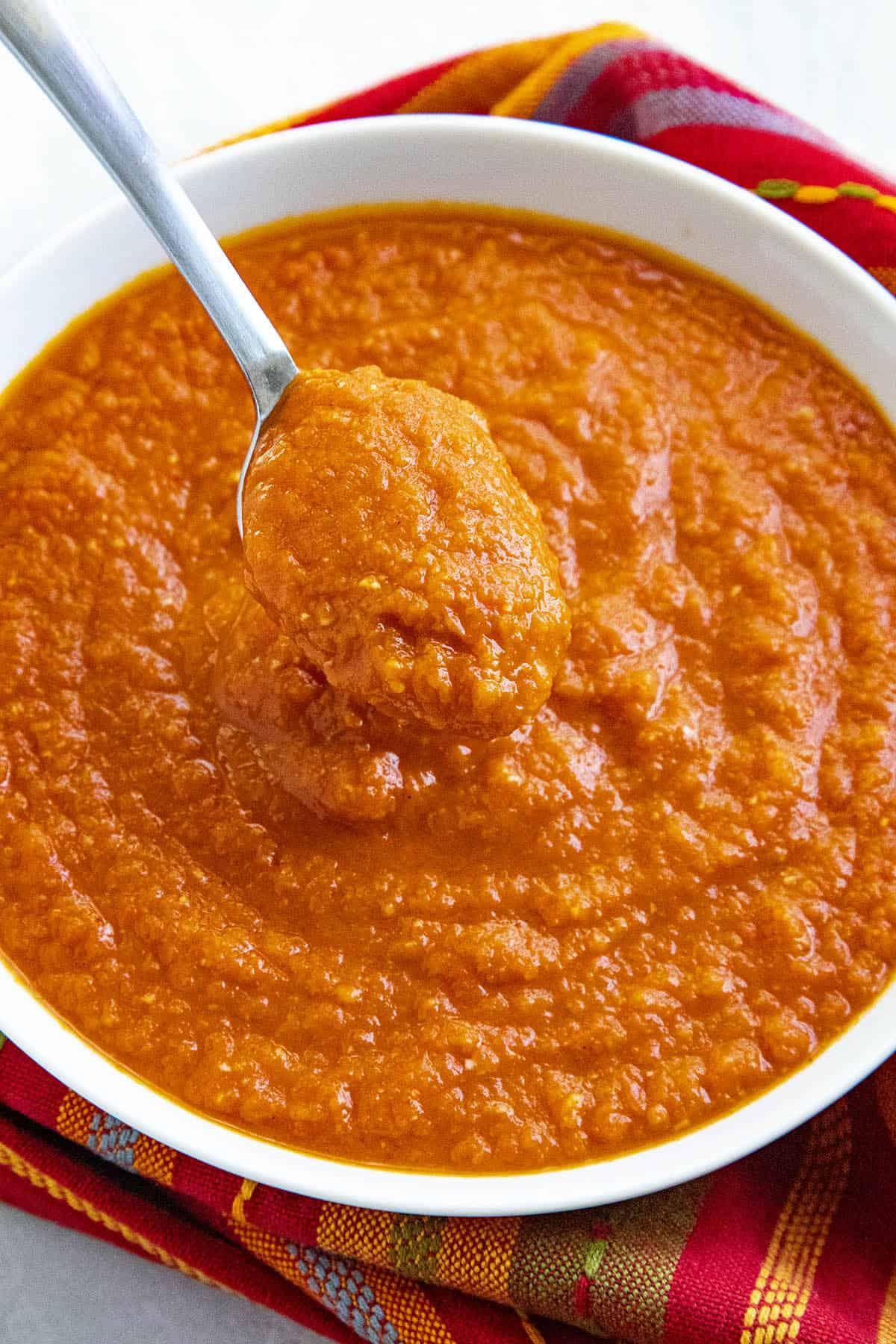 Bravas Sauce on a spoon, ready to serve