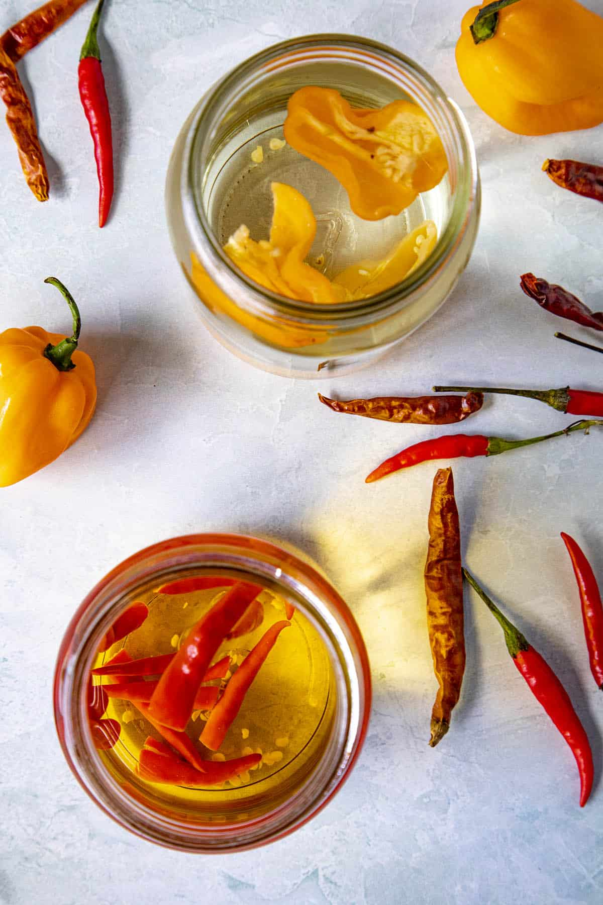 Spicy infused alcohol in jars with extra peppers