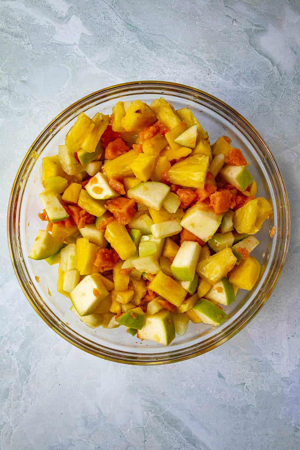 Rujak ingredients mixed into a bowl