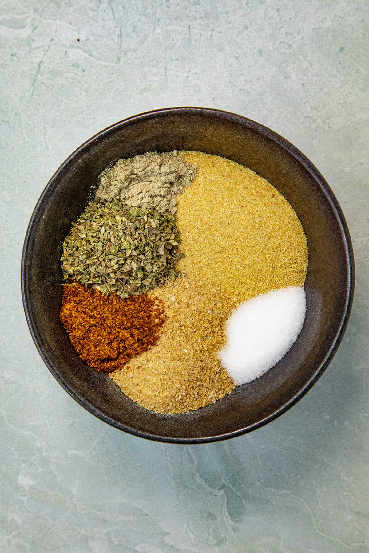 Adobo Seasoning ingredients in a bowl, ready to mix