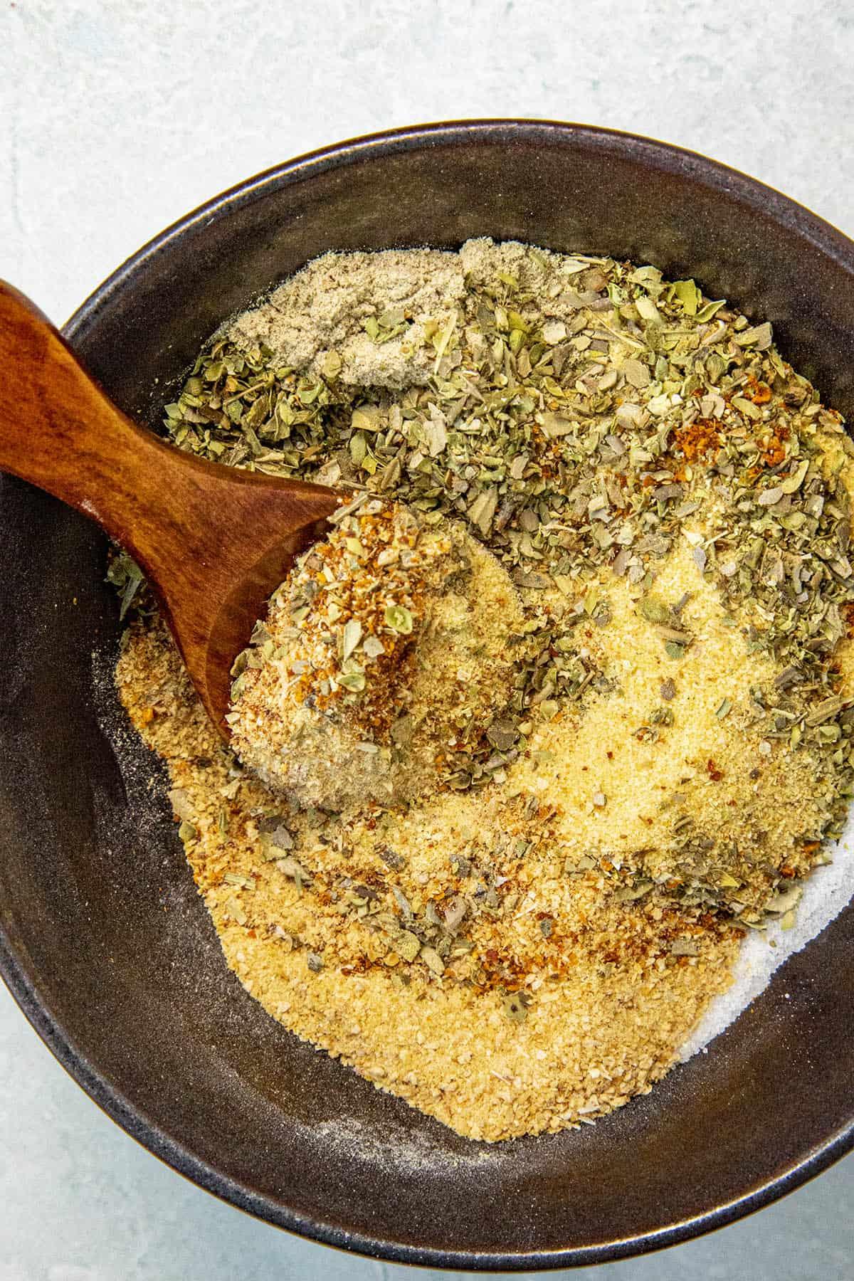 Adobo Seasoning ingredients being mixed in a bowl