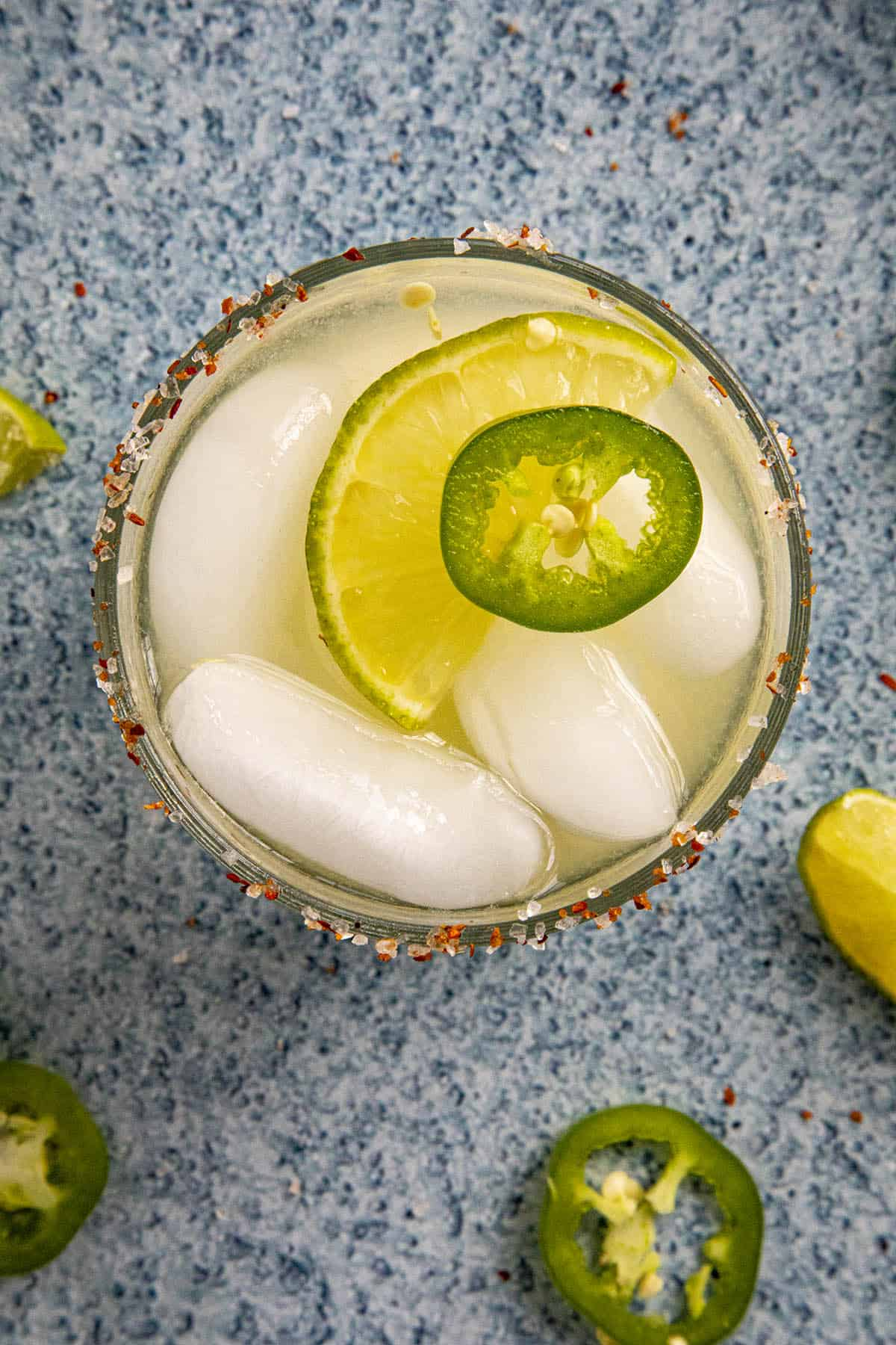 Jalapeno Margarita garnished with a lime wedge and jalapeno slice