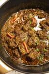 Beef Rendang simmering in a pot