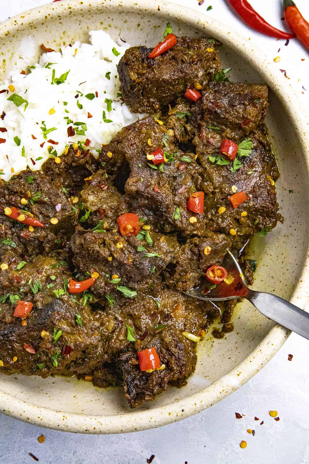 Beef Rendang in a bowl with a spoon