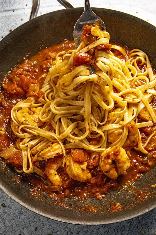 Twirling Shrimp Fra Diavolo pasta on a fork