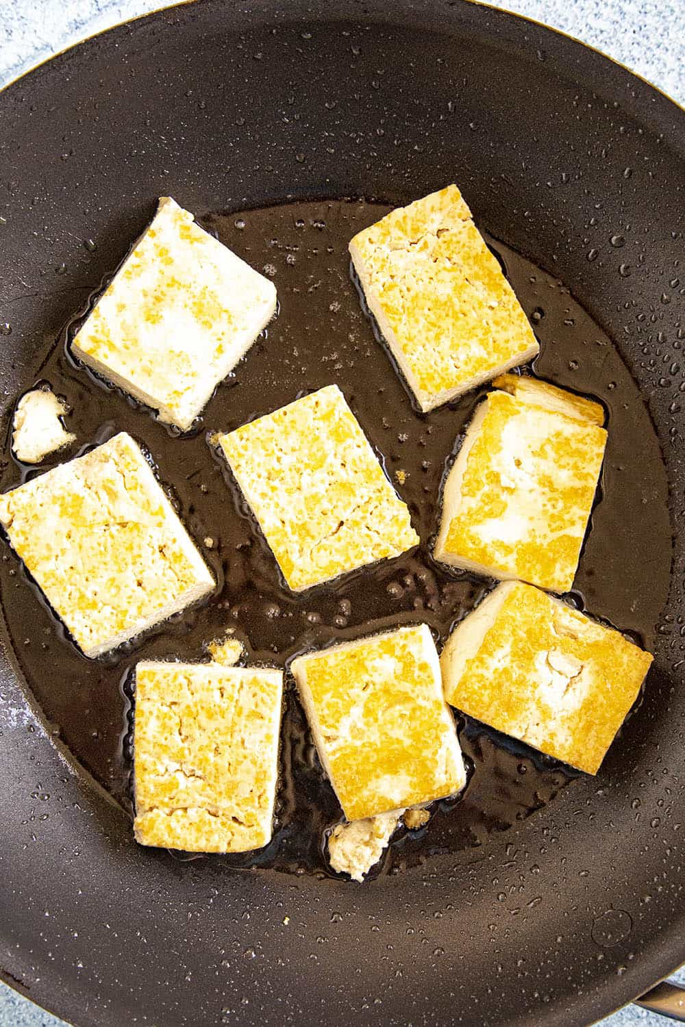 Frying blocks of tofu for making sofritas