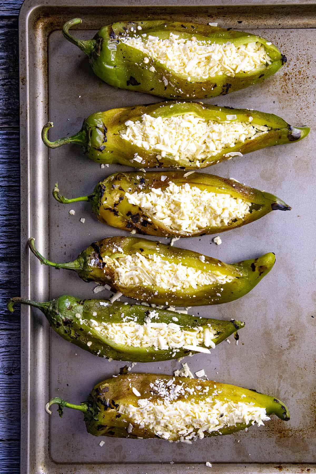Stuffing roasted chiles with melty cheese