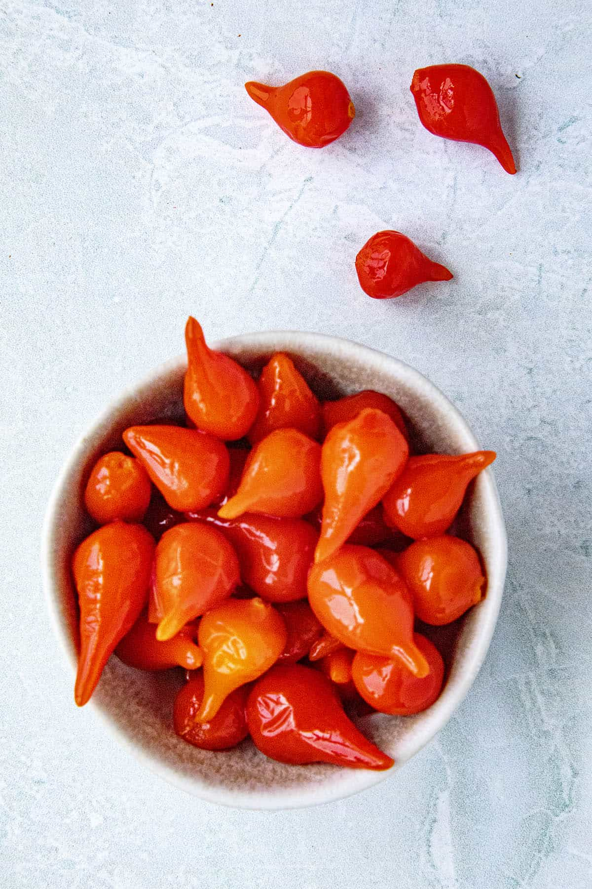 A handful of Roquito Peppers in a bowl