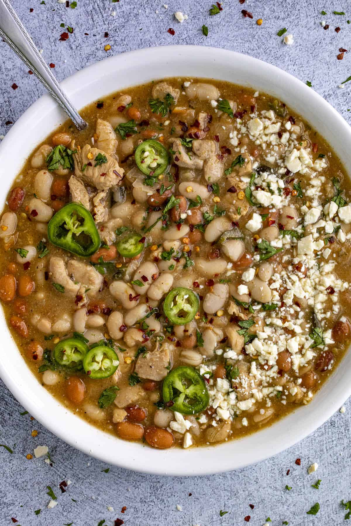 White Bean Chicken Chili in a bowl with lots of garnish