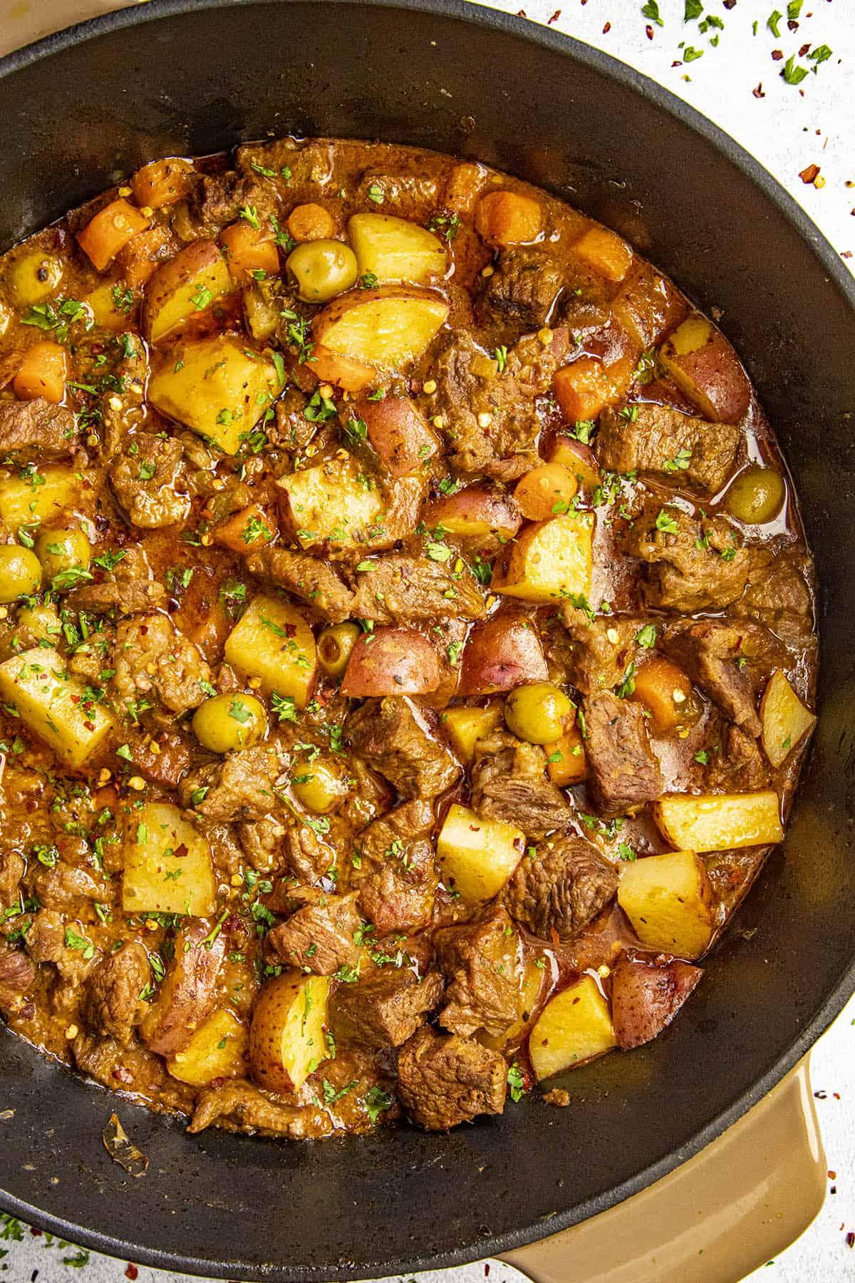 Hearty, meaty Carne guisada (beef stew) in a pot