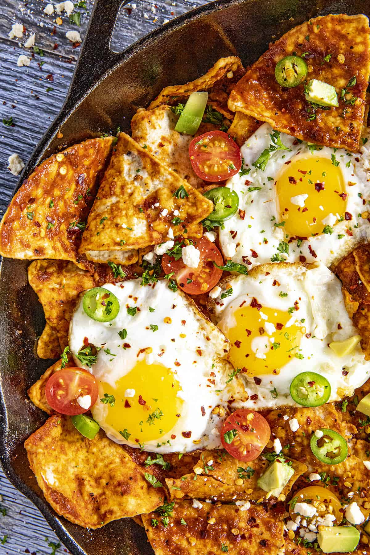 Big scoops of saucy chilaquiles rojos with fried eggs
