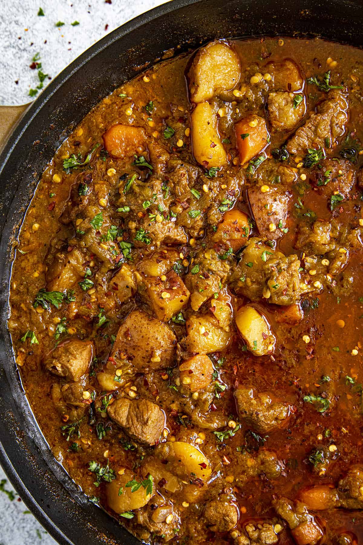 Chunky Green Chili Stew in a pot with lots of pork and potatoes