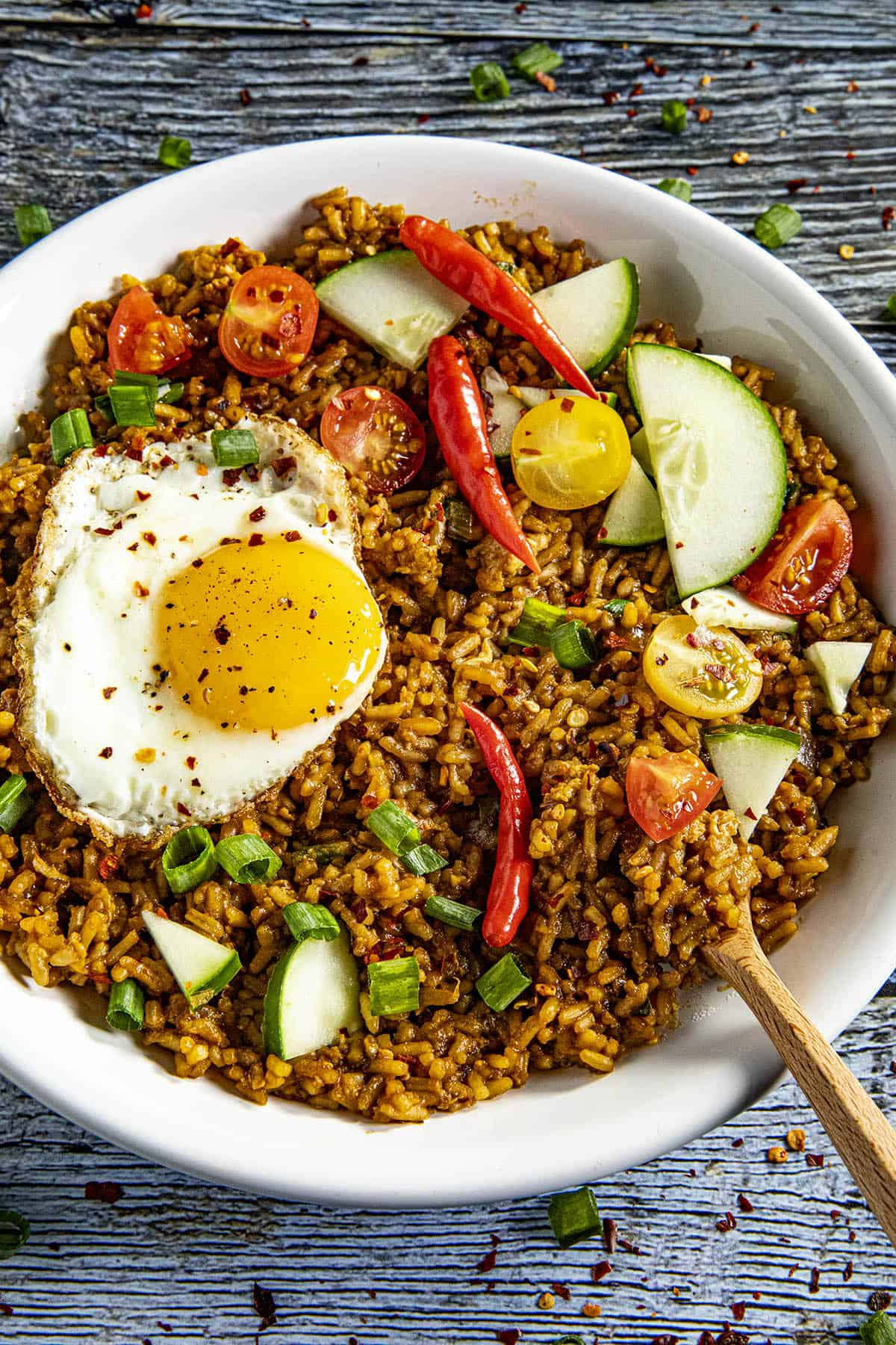Nasi Goreng - Indonesian Fried Rice in a bowl with a fried egg on top