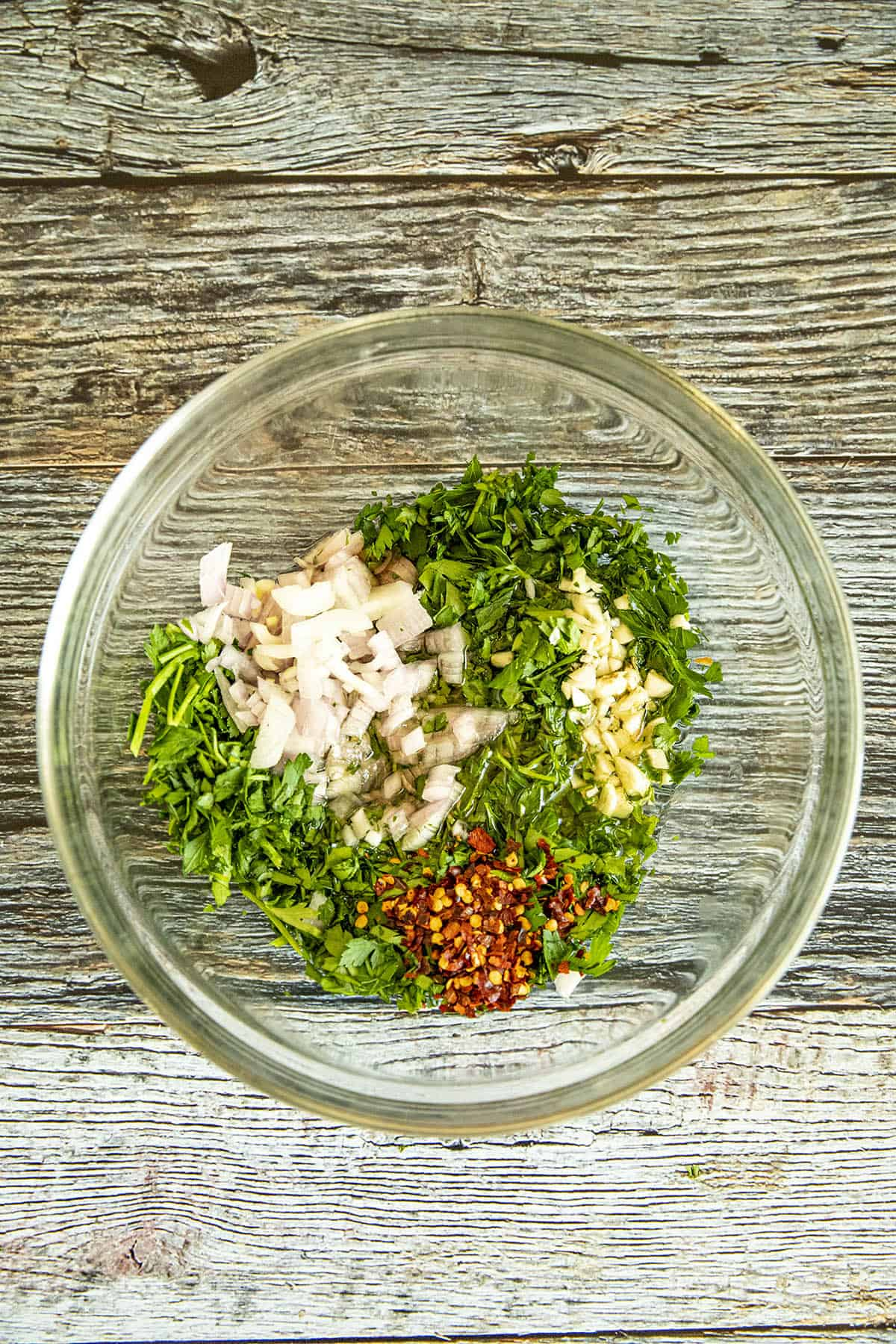 Chimichurri ingredients in a bowl