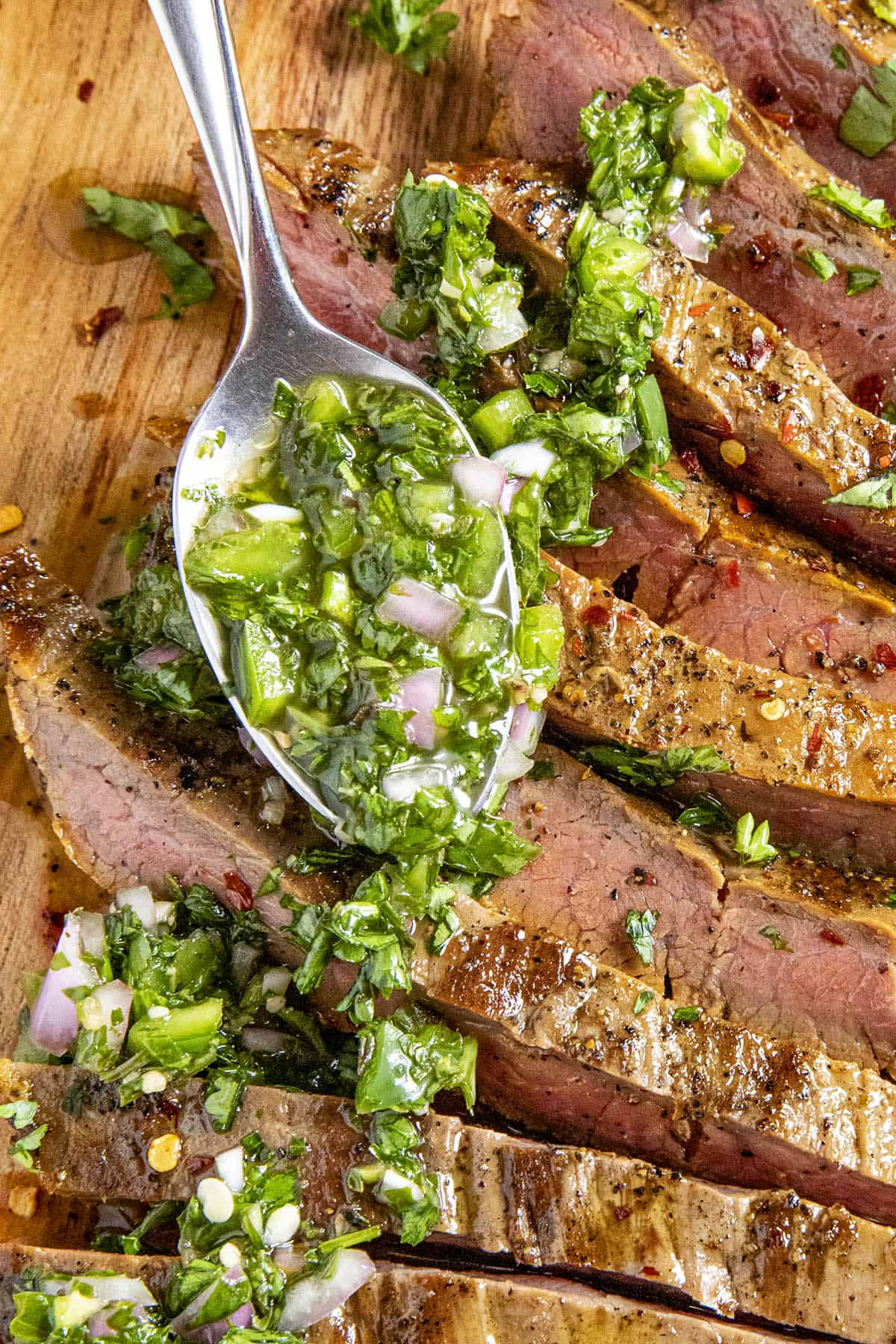 A heaping spoonful Chimichurri over flank Steak
