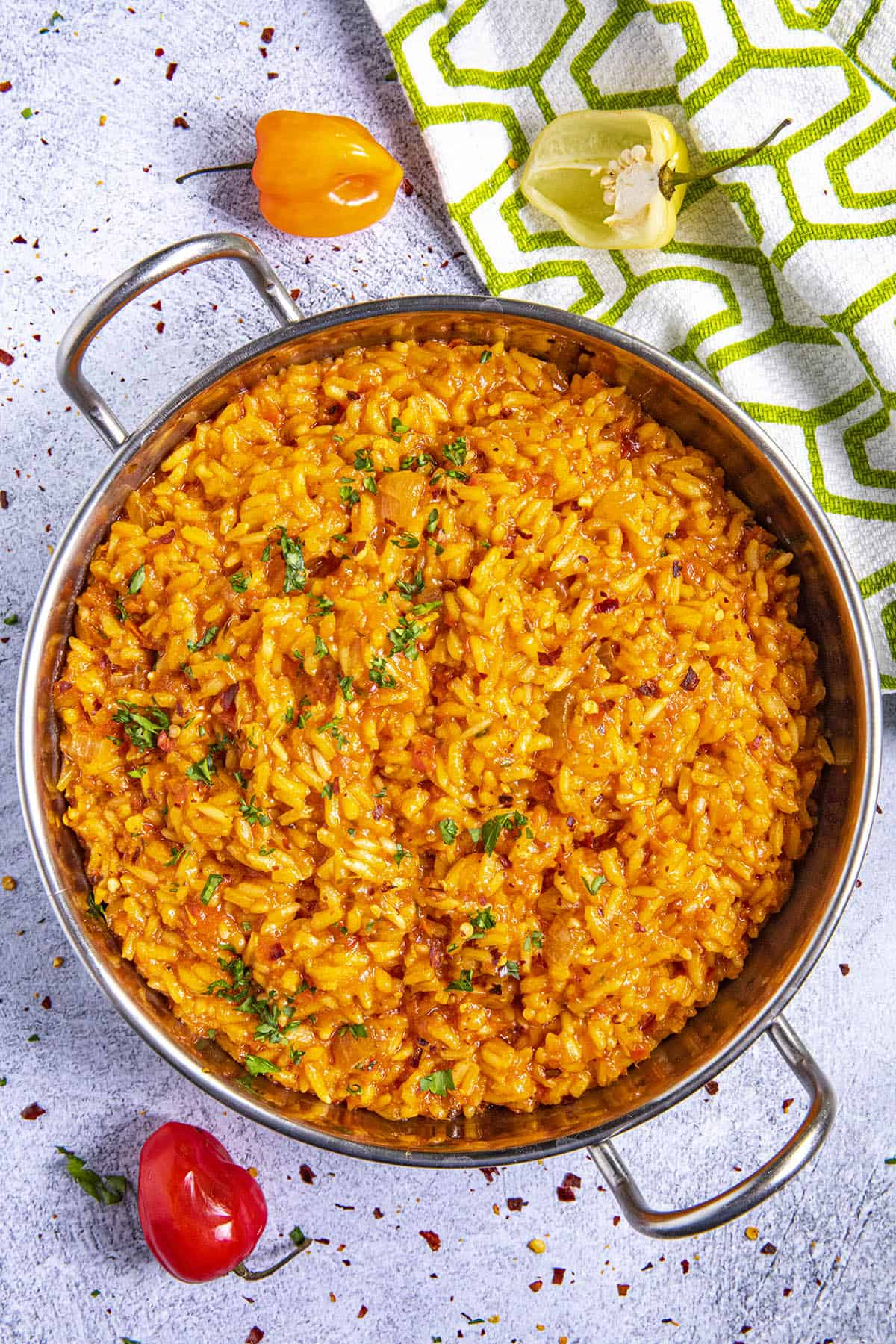 Jollof Rice in a bowl with extra scotch bonnet peppers